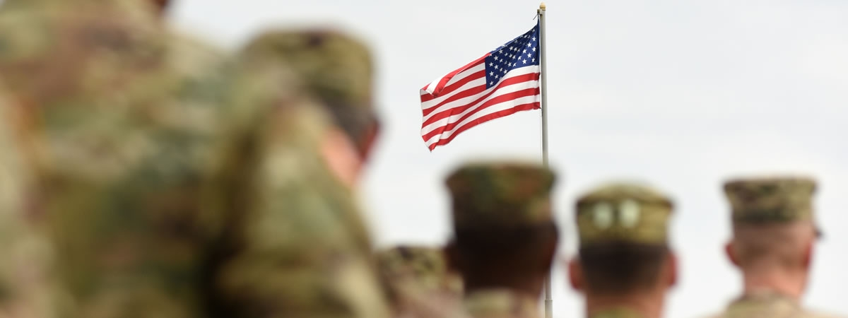 group of soldiers saluting the flag