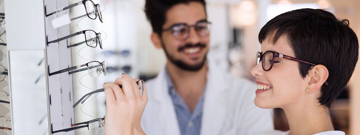 optician and customer in dispensary